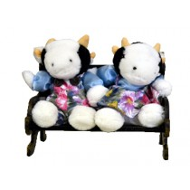 COW COUPLE W/BLUE FLORAL ON BENCH