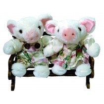 PIGGY COUPLE W/WHITE FLORAL ON BENCH