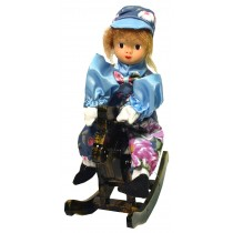 BOY W/BLUE FLORAL PRINT ROCKING HORSE