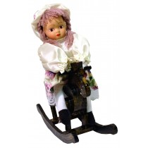 GIRL W/WHITE FLORAL SKIRT ROCKING HORSE